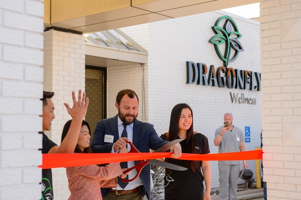 (Trent Nelson | The Salt Lake Tribune) Narith Panh, Hoang Nguyen, Andrew Rigby, and Lien Nguyen prepare to cut the ribbon as Dragonfly Wellness becomes the first of Utah's 14 medical cannabis pharmacies to open for business in Salt Lake City on Monday, March 2, 2020.