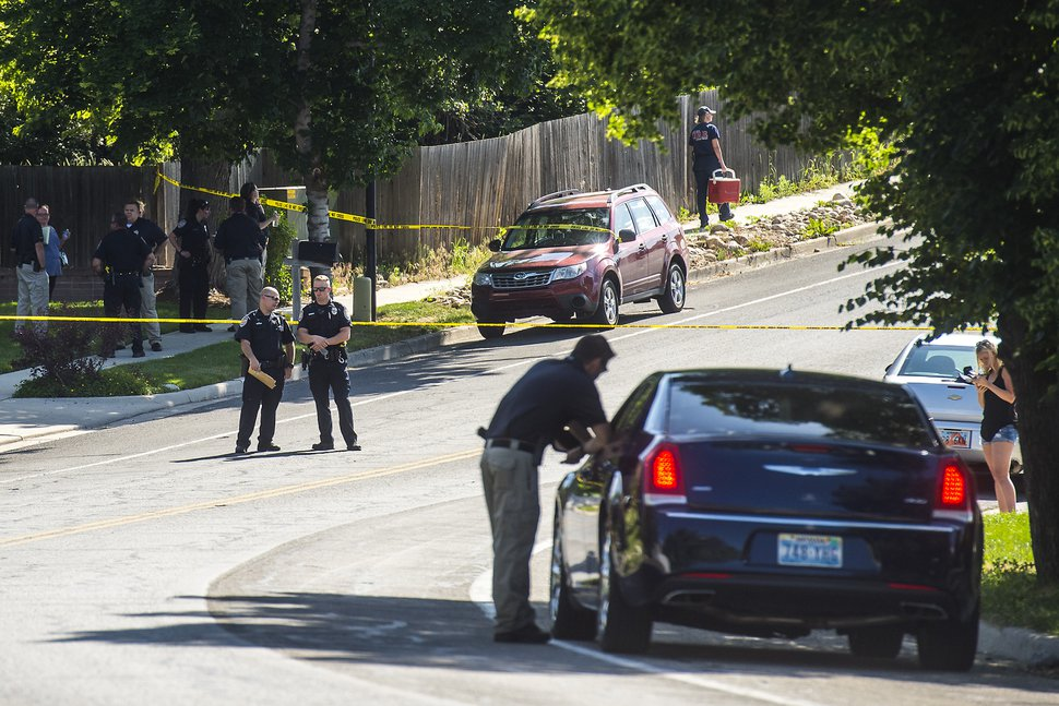 Chris Detrick   The Salt Lake Tribune Police officers investigate the scene of a shooting Tuesday, June 6, 2017. The shooting occurred at about 3:45 p.m. outside of a residence at about 2175 East and Alta Canyon Drive (about 8630 South), said Sandy police Sgt. Jason Nielsen. Nielsen said the shooter was among the dead and, therefore, there is no threat to the public.
