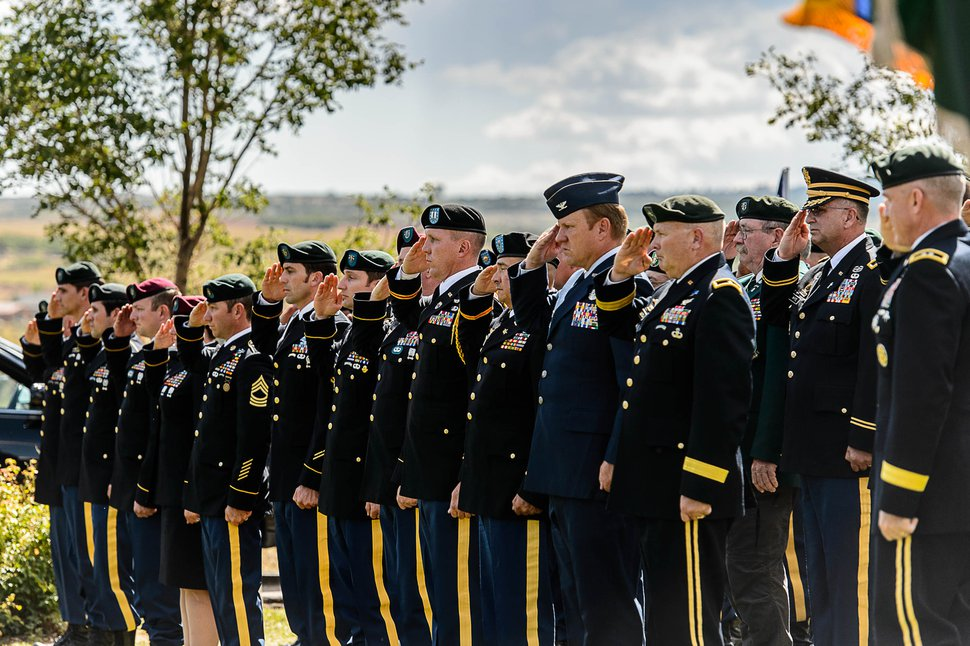 (Trent Nelson | The Salt Lake Tribune) Pallbearers at the graveside service for fallen soldier Aaron Butler, in Monticello Saturday August 26, 2017.