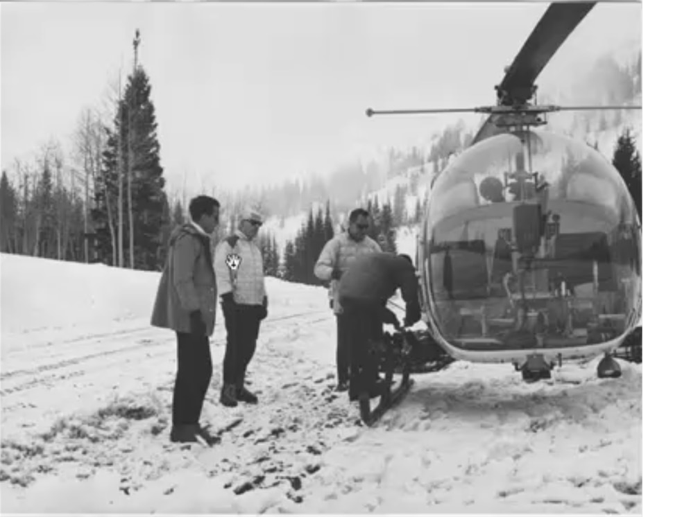 (Courtesy photo of Jack Smith) Architects Jack Smith, left, and Dan Kiley with pilot Bob Smith load a helicopter in Little Cottonwood circa 1966 during the planning of a ski resort that would become Snowbird.
