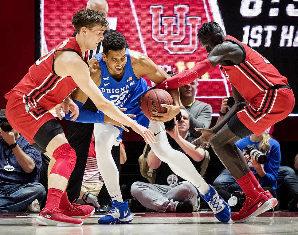 (Michael Mangum | Special to The Tribune) Brigham Young Cougars forward Yoeli Childs (23) is double-teamed by Utah Utes forward Mikael Jantunen (20), left, and Utah Utes guard Both Gach (11) during their game at the Huntsman Center in Salt Lake City on Wednesday, Dec. 4, 2019.