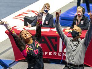 (Rick Egan | The Salt Lake Tribune) Cristal Isa and Utah head coach Tom Farden react after Isa lands her dismount from the uneven bars, in PAC-12 gymnastics action Utah vs Arizona, at the Huntsman Center onSaturday, Jan. 23, 2021.