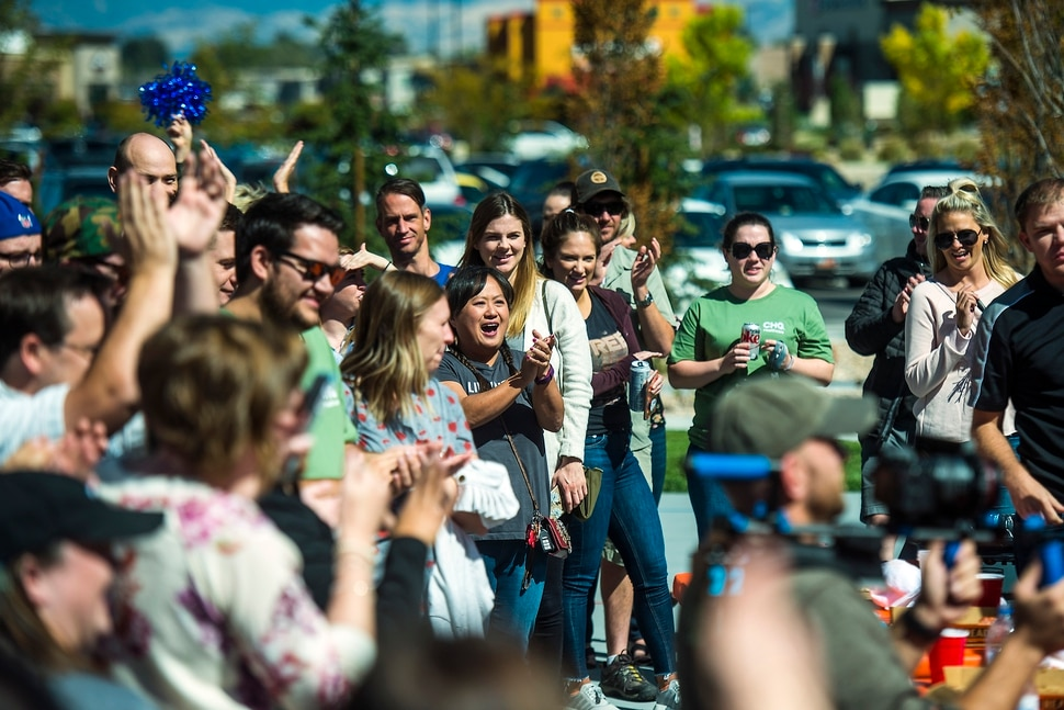 (Chris Detrick | The Salt Lake Tribune) Spectators cheer as fellow employees compete in a pizza eating competition during a fundraiser for United Way at CHG Healthcare Wednesday, September 20, 2017.