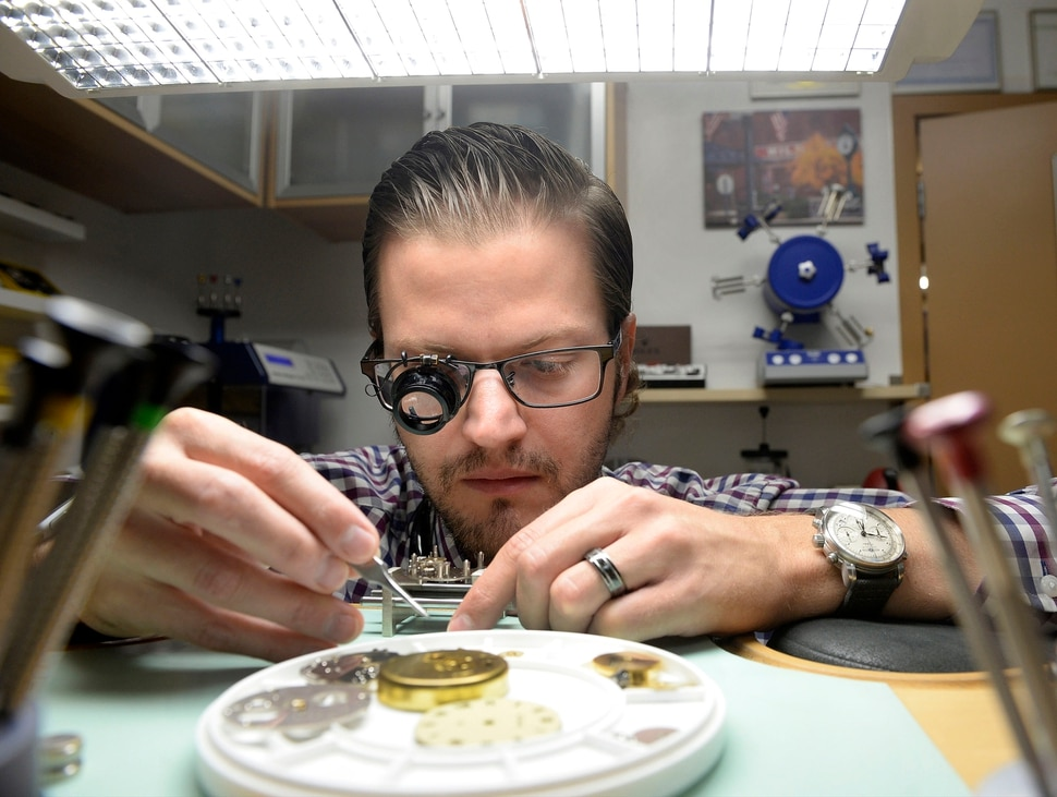 (Al Hartmann | The Salt Lake Tribune) Aaron Recksiek repairs an older vintage pocket watch at Mt. Olympus Clock with steady hands and a good magnifier. He's carrying on in the family business that started in 1958.