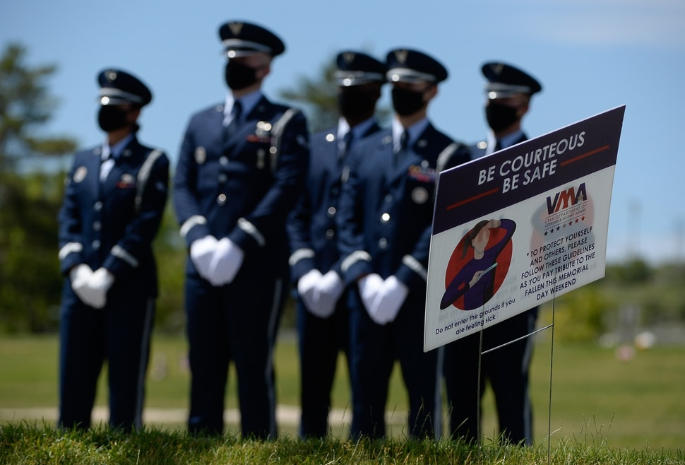 (Francisco Kjolseth | The Salt Lake Tribune ) Signs point to caution due to COVID-19 as members of the Hill Air Force Base color guard await the arrival of the casket of Dallas Lynn Stevens at the Utah Veterans Cemetery in Bluffdale on Wednesday, June 24, 2020.