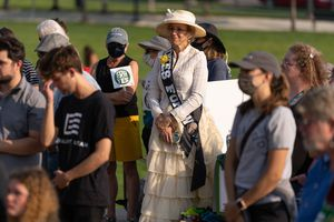 (Francisco Kjolseth   The Salt Lake Tribune) Erin Preston, dressed as her great, great grandmother, Lucy Augusta Rice Clark, who she says was the first woman to vote in a Republican National Convention, joins the rally on Women's Equality Day at the Capitol on Thursday, Aug. 26, 2021, to encourage Utah to ratify the Equal Rights Amendment.