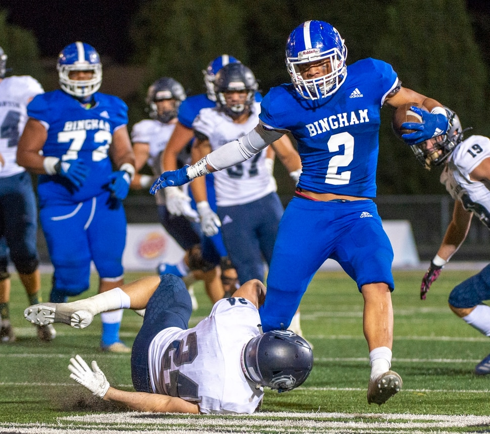 (Rick Egan | The Salt Lake Tribune) Trevor Ogden grabs running back Saia Lomu as he runs the ball for Bingham, in prep action between the Bingham Miners and the Corner Canyon Chargers, at Bingham High on Friday, Aug. 28, 2020.