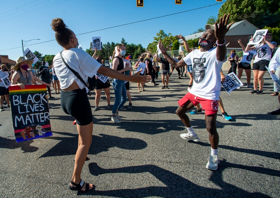 (Rick Egan | The Salt Lake Tribune) Bella Swan and Manson Kafi dance to the Jackson 5, with protesters on Foothill Drive during a march for Justice on Sunday, July 12, 2020.