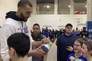(Eric Walden  |  The Salt Lake Tribune) Utah Jazz center Rudy Gobert signs some autographs for school children at the All-Star Weekend Jr. NBA Day event at Navy Pier in Chicago on Friday, Feb. 14, 2020.