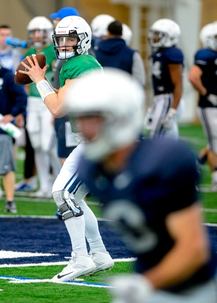 (Steve Griffin | The Salt Lake Tribune) BYU quarterback Beau Hoge runs a play during spring football practice at the indoor practice facility in Provo Thursday March 15, 2018.