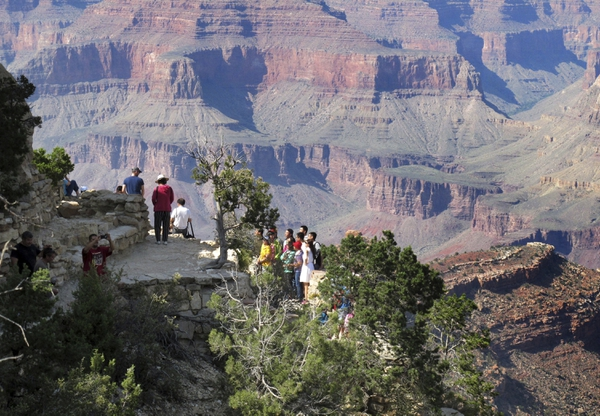 (AP file photo) Visitors gather at an outlook on the South Rim of Grand Canyon National Park in northern Arizona. Democratic senators are harshly criticizing a National Park Service plan to impose steep increases in entrance fees at 17 of its most popular parks, including the Grand Canyon, Yosemite, Yellowstone and Zion.