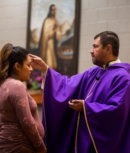 (Rick Egan | The Salt Lake Tribune) Maria Camarena receives the ashes from the Rev. Jose Fidel Barrera-Cruz during Ash Wednesday Mass at Our Lady of Guadalupe Church in Salt Lake City on Wednesday, March 6, 2019.