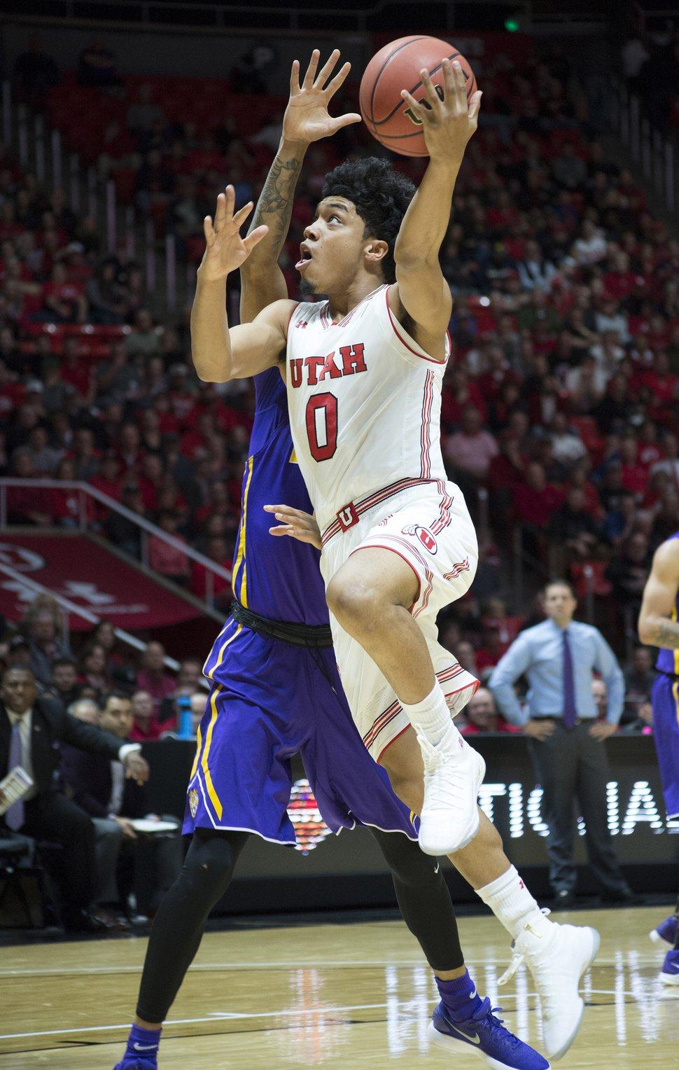 (Rick Egan | The Salt Lake Tribune) Utah Utes guard Sedrick Barefield (0) takes the ball to the hoop, in NIT playoff action between Utah Utes and LSU Tigers at the Jon M. Huntsman Center, Monday, March 19, 2018.