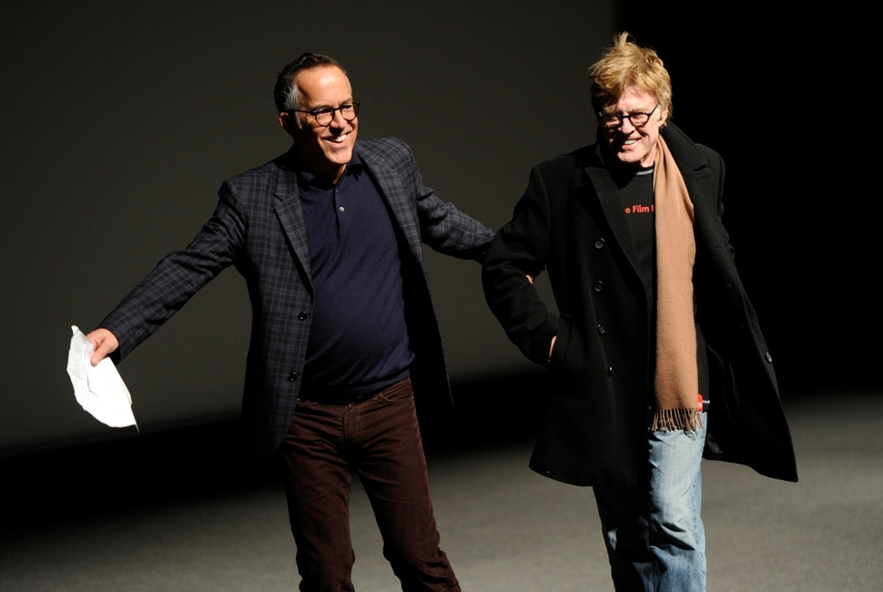 John Cooper, left, director of programming for the Sundance Film Festival, leads Robert Redford, founder of the Sundance Institute, to the podium before the premiere of the documentary film What Happened, Miss Simone?, on the opening night of the 2015 Sundance Film Festival on Thursday, Jan. 22, 2015, in Park City, Utah. (Photo by Chris Pizzello/Invision/AP)