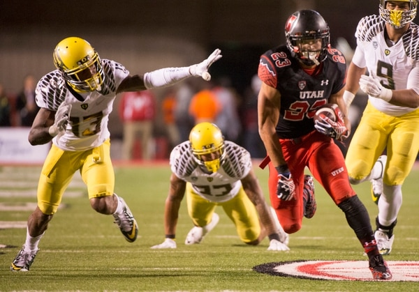 Rick Egan | The Salt Lake Tribune Ute running back Devontae Booker (23) runs the ball into the end zone for a touchdown, in Pac-12 football action, Utah vs. Oregon game, at Rice-Eccles Stadium, Saturday, November 8, 2014