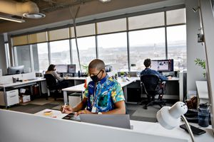 (Kim Raff   The New York Times) Employees with Vivint, a home security business, work at their office in Lehi, Utah, Feb. 16, 2021. As vaccination rates rise, Utah's unemployment rate fell to 2.7% in May, well below the national rate of 5.8%.