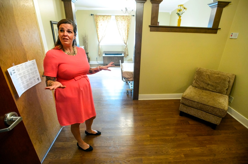 (Steve Griffin | The Salt Lake Tribune) Matilda Lindgren, program director for the INN Between, a hospice for the homeless in Salt Lake City, shows one of the rooms at the facility's new home, an existing assisted living facility at 1216 E. 1300 South in Salt Lake City, on Thursday, May 3, 2018.