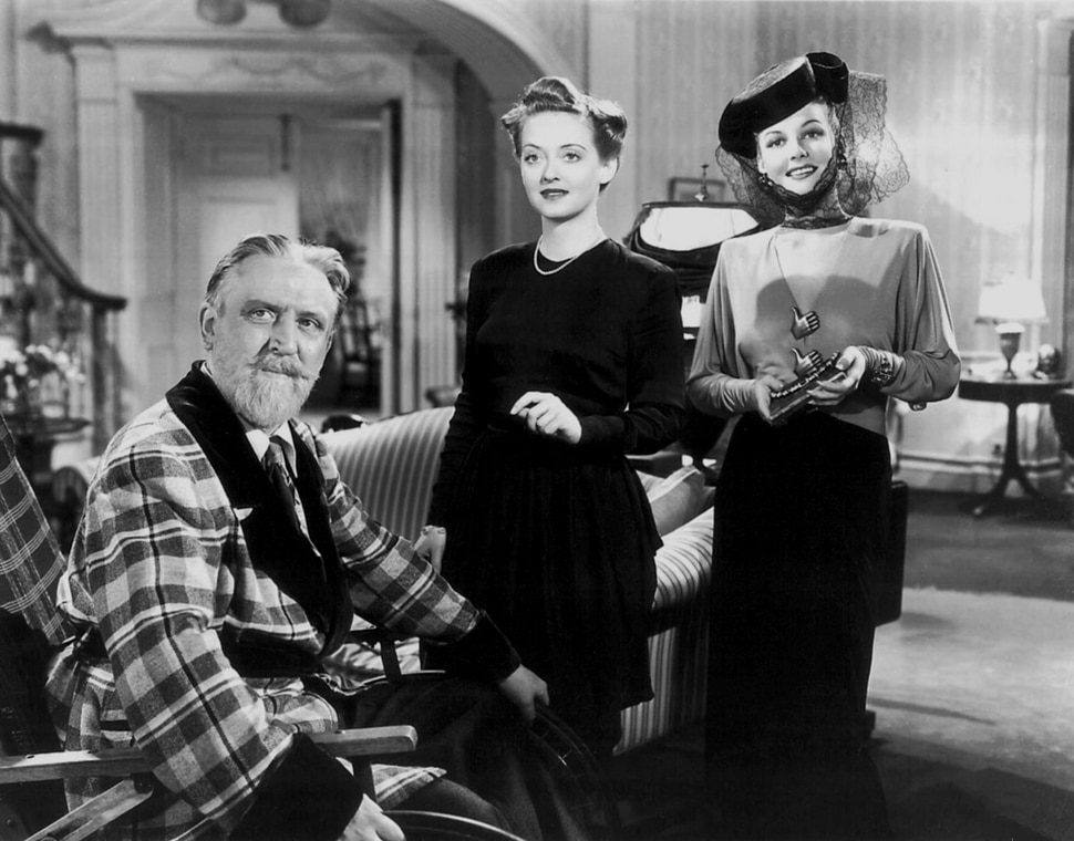 ( Courtesy Warner Bros. Pictures) Monty Woolley, left, plays New York radio personality Sheldon Whiteside, who takes over the lives of an Ohio family in the 1942 comedy The Man Who Came to Dinner. Bette Davis (center) plays Whiteside's long-suffering assistant, Maggie Cutler; Ann Sheridan (right) plays Lorraine Sheldon, an actress brought in to disrupt Maggie's romantic plans with a young journalist.