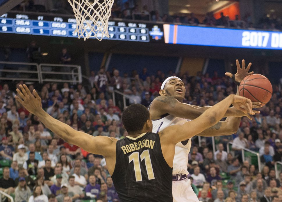 Chris Detrick | The Salt Lake Tribune Northwestern Wildcats center Dererk Pardon (5) is defended by Vanderbilt Commodores forward Jeff Roberson (11) during first round of the NCAA Tournament in Salt Lake City on Thursday, March 16, 2017.