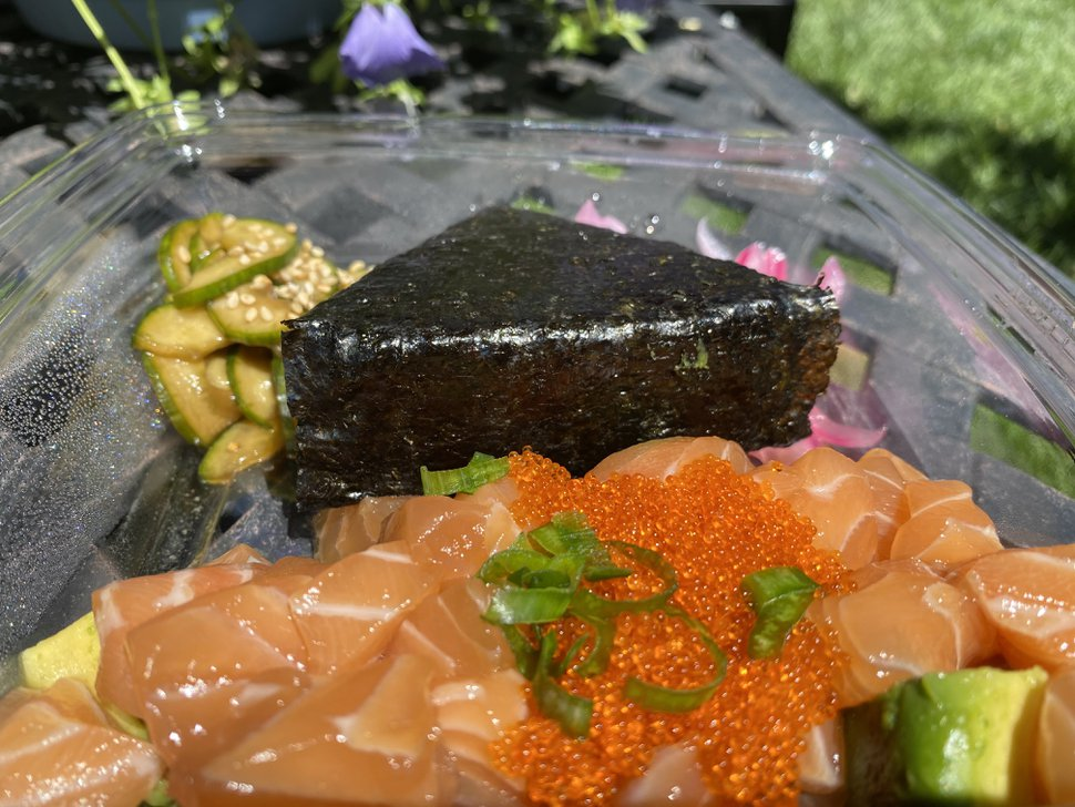 (Heather L. King | Special to The Tribune) The poke from Ghost Sushi in Salt Lake City comes with meaty cuts of fish, delicately pickled cucumbers and onions and hand-wrapped onigiri rice.