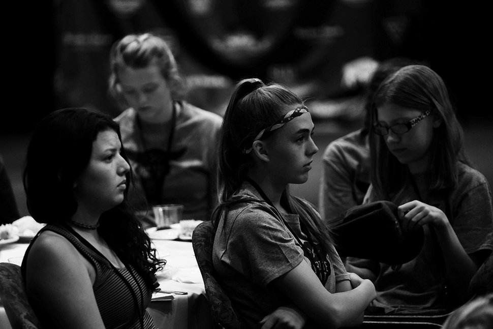 (Photo courtesy of Scott Condie) Ellie Seegmiller, far right, reads during WriteOut camp in 2017.