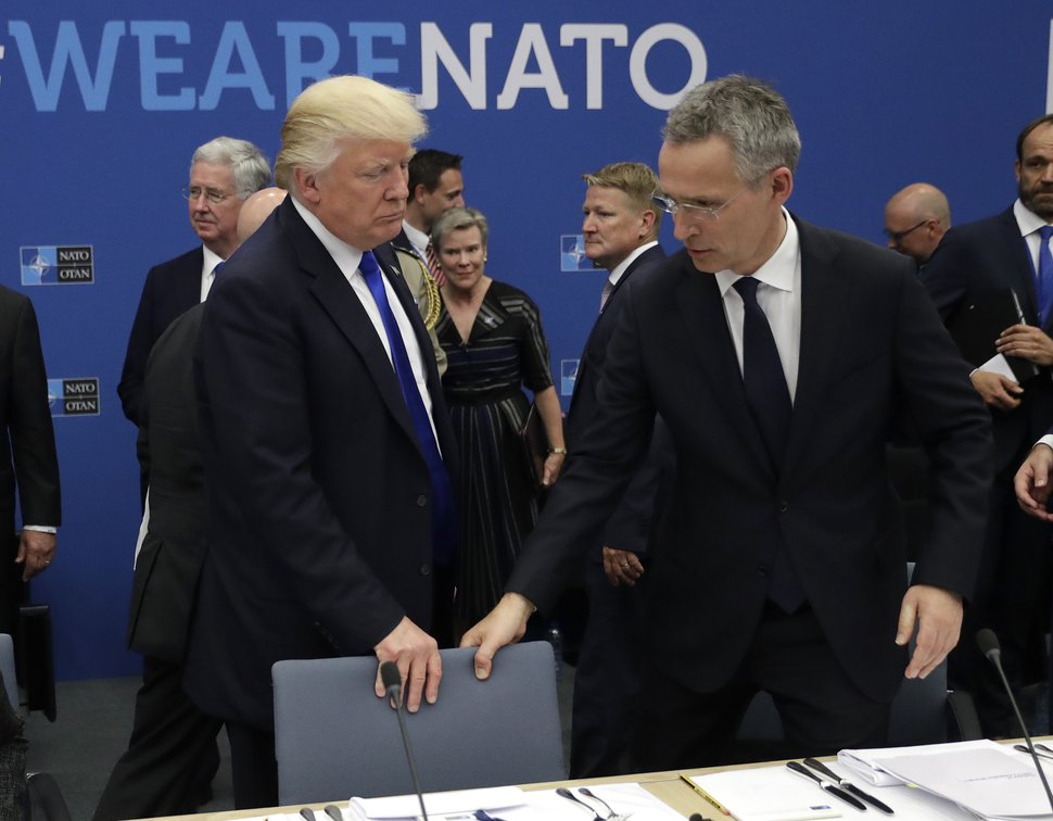 FILE - In this Thursday, May 25, 2017 file photo, U.S. President Donald Trump, left, and NATO Secretary General Jens Stoltenberg take a seat during a working dinner at a NATO summit in Brussels. When Donald Trump walks into a NATO summit Wednesday, July 11, 2018, international politics are bound to become intensely personal _ again. (AP Photo/Matt Dunham, Pool, File)