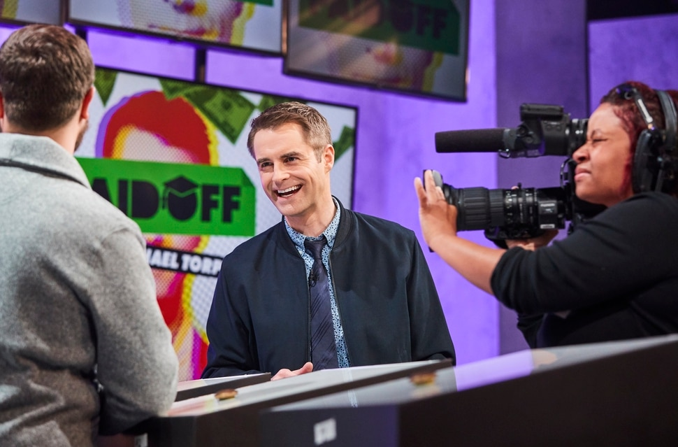 (Photo courtesy of truTV) Host Michael Torpey on the set of Paid Off.