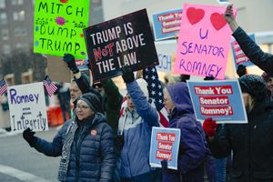 (Francisco Kjolseth   Tribune file photo) In this Feb. 5, 2020, file photo, people gather in support of Sen. Mitt Romney, R-Utah, at the Wallace F. Bennett Federal Building in Salt Lake City on Wednesday after he voted to convict President Donald Trump of abuse of power. The Utah senator was the only Republican to vote guilty on the first article of impeachment.