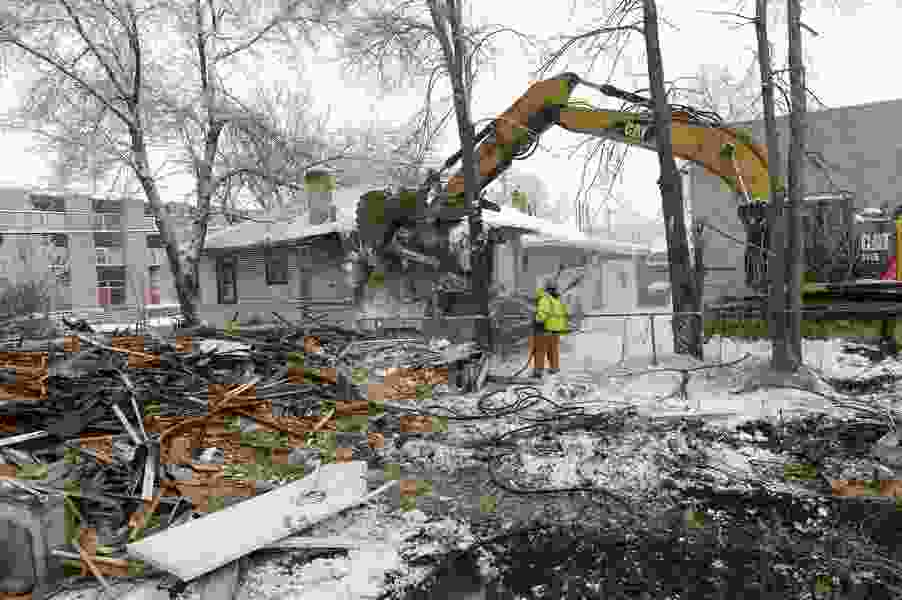 Demolition begins on derelict buildings in Ballpark neighborhood slated to become a 55-unit apartment community