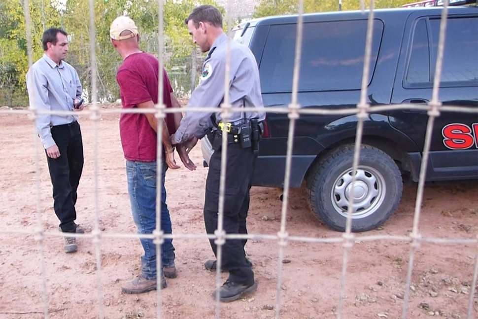 | Courtesy Sam Brower Andrew Chatwin being placed under arrest.
