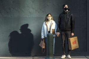 (Rick Egan | The Salt Lake Tribune)  Jazzy and Boston McClary wear masks as they wait at a stop light in downtown Salt Lake City, on Thursday, Nov. 12, 2020.