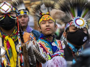 (Leah Hogsten   The Salt Lake Tribune) Young men from Native American tribes throughout the West show their regalia during the Grand Entry at the 41st Annual Paiute Indian Tribe of Utah Restoration Gathering, Aug. 13, 2021 in Cedar City, Utah.