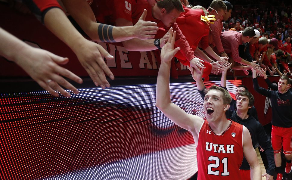 Utah forward Tyler Rawson celebrates with fans following the team's 84-78 win over UCLA in an NCAA college basketball game Thursday, Feb. 22, 2018, in Salt Lake City. (AP Photo/Rick Bowmer)