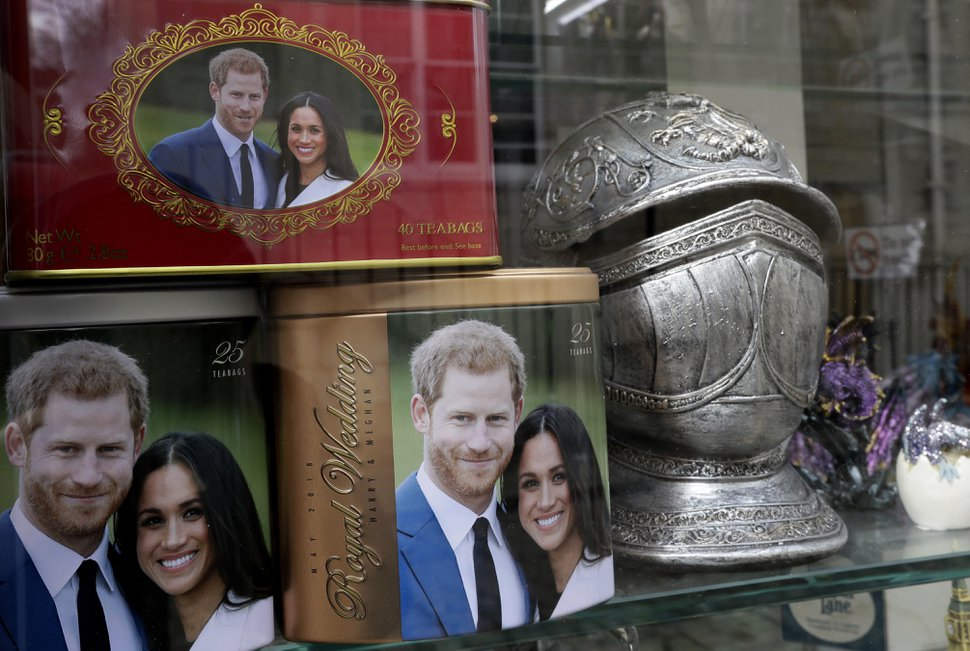 Memorabilia with a photograph of Britain's Prince Harry and fiancée Meghan Markle are displayed for sale in a shop window in Windsor, England, Thursday, March 29, 2018. Harry will marry Markle in Windsor on May 19. (AP Photo/Kirsty Wigglesworth)