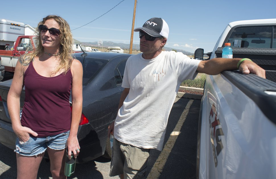 (Rick Egan | The Salt Lake Tribune) Leila and Chad Hintze found out that their cabin burned to the ground in the fire during a community meeting in Fruitland, Tuesday, July 10, 2018.