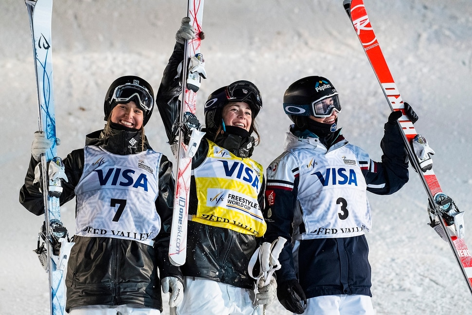(Chris Detrick | The Salt Lake Tribune) USA's Morgan Schild (7) USA's Jaelin Kauf (1) and France's Perrine Laffont (3) celebrate after the Ladies' Mogul Finals during the FIS Visa Freestyle International Ski World Cup at Deer Valley Resort Thursday, January 11, 2018. Schild finished in third place. Kauf finished first and Laffont finished second.
