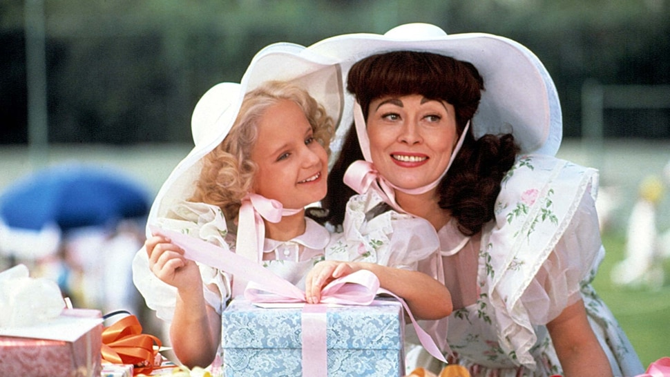 Faye Dunaway (right) plays movie legend Joan Crawford, with her adopted daughter Christina (Mara Hobel), in the 1981 drama Mommie Dearest. (Courtesy Paramount Pictures)