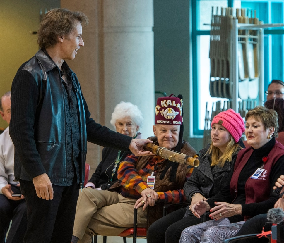 (Rick Egan | The Salt Lake Tribune) Kurt Bestor entertains the crowd at Shriners' Hospital passing around instruments he has collected from around the world. Tuesday, Nov. 19, 2019.