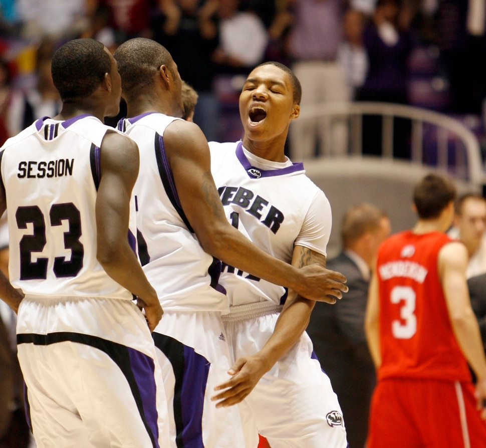 (Steve Griffin | Tribune file photo) Weber State's Damian Lillard jumps into the arms of his teammates after leading the Wildcats to an 83-76 victory over Utah in 2009 at the Dee Events Center in Ogden.