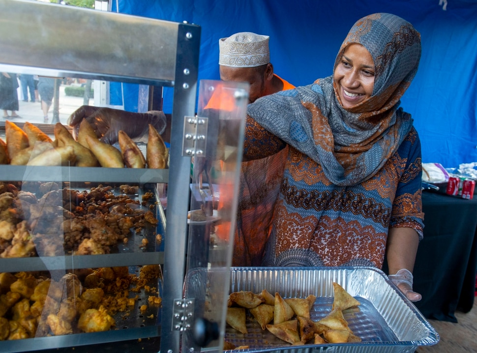 (Rick Egan | The Salt Lake Tribune) Najati Abbanna cooks Swahili Cuisine in the Namash booth at the Gallivan Center, as Salt Lake City's Spice Kitchen Incubator program serves a variety of international cuisine at the welcome party for the United Nations Civil Society Conference, Sunday, Aug. 25, 2019.