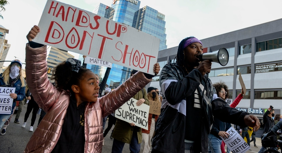 (Leah Hogsten | The Salt Lake Tribune) Demonstrators with Black Lives Matter marched from the Utah Capitol down State Street, stopping at every intersection for five minutes in honor of George Floyd, June 8, 2020.