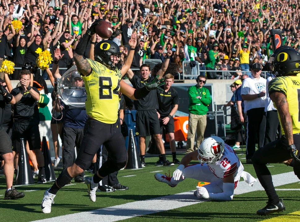 Oregon tight end Cam McCormick, left, celebrates a first quarter touchdown against Utah in an NCAA college football game Saturday, Oct. 28, 2017, in Eugene, Ore. (AP Photo/Chris Pietsch)