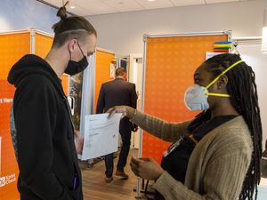 (Rick Egan | The Salt Lake Tribune)  Kezala Jokiel gets his Covid-19 test results from medical assistant Lolanna Eiland, at XpresCheck, which opened today for passengers at the Salt Lake City International Airport on Wednesday, Jan. 20, 2021.