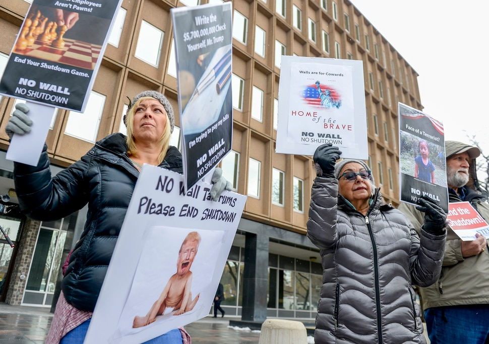 Leah Hogsten | The Salt Lake Tribune l-r Dawn Malan and her mother Maria Anita Gutierez Cope and John Bellmon rally with Internal Revenue Service employees in protest of the ongoing partial federal shutdown outside the Federal Building in Ogden, Jan. 10, 2019.