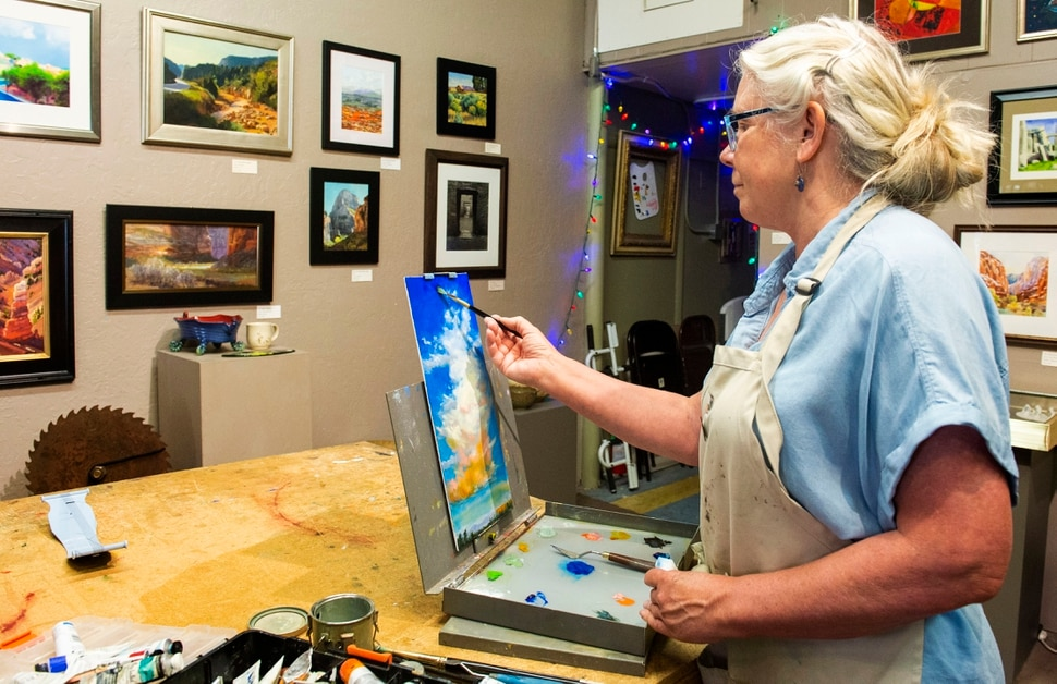 (Rick Egan | The Salt Lake Tribune) Diane Walsh paints in the Artisans Art Gallery in Cedar City, Wednesday, June 19, 2019.