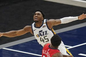 (Rick Bowmer | AP) Utah Jazz guard Donovan Mitchell (45) watches after laying the ball up over New Orleans Pelicans guard Eric Bledsoe (5) during the first half of an NBA basketball game Thursday, Jan. 21, 2021, in Salt Lake City.