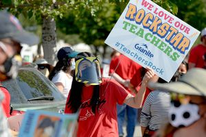 (Francisco Kjolseth  |  The Salt Lake Tribune) Sellika Reese, a first grade English teacher who teaches phonics, wears what she would need to teach which would make it very difficult for her students to understand her as she joined hundreds of Granite School district teachers gathered at the Granite School District office on Tuesday, August 4, 2020. The teachers were protesting the district's plans for reopening, which will allow students back into the classroom, like normal, five days a week.
