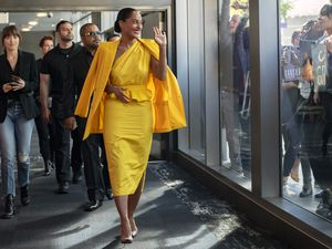 "(Glen Wilson  |  Focus Features) Singing star Grace Davis (Tracee Ellis Ross, center) waves to her fans, walking ahead of her assistant, Maggie Sherwoode (Dakota Johnson, left), and her manager, Jack Robertson (Ice Cube), in a scene from the comedy-drama ""The High Note."""