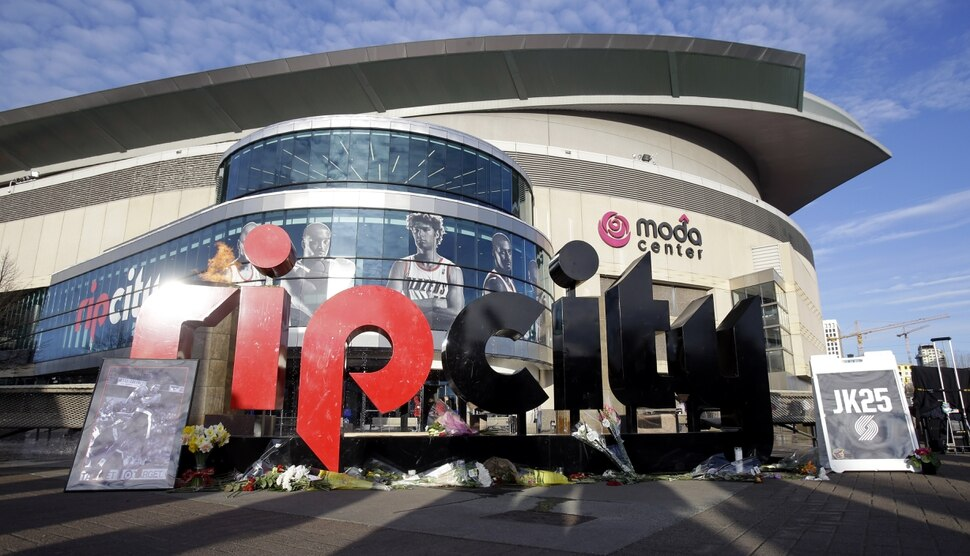 A makeshift memorial for former Portland Trail Blazer player Jerome Kersey is shown under the rip city sign outside the Moda Center before an NBA basketball game against the Memphis Grizzlies in Portland, Ore., Sunday, Feb. 22, 2015. Kersey, who was part of the Trail Blazers staff, passed away suddenly earlier this week at the age of 52. (AP Photo/Don Ryan)