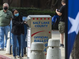(Rick Egan     The Salt Lake Tribune)    Voters drop their ballots in the vote-by-mail ballot drop box at the Salt Lake County Government Center on Monday, Oct. 19, 2020.